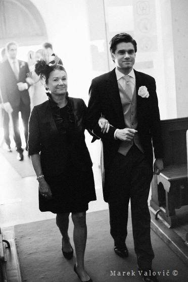 groom entering church with mother