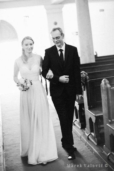 bride entering church with her father in BW