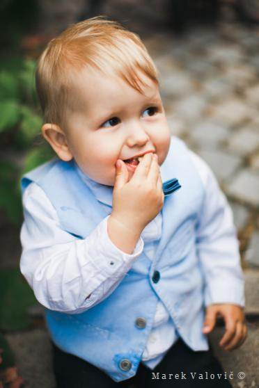 kid on the wedding - little boy eating