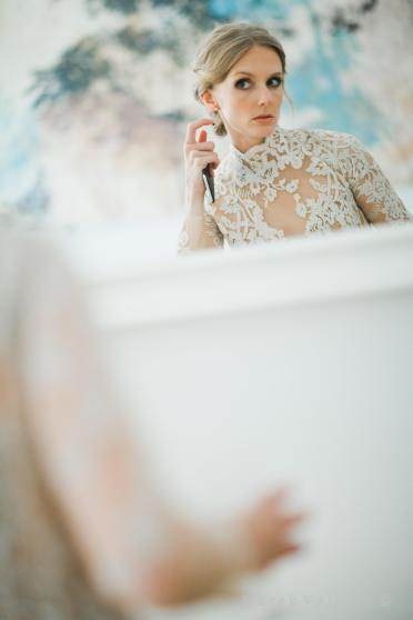 bride checking in mirror