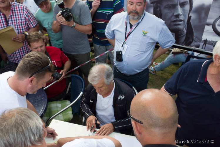 photojournalistic photography | Giacommo Agostini signing fan cards