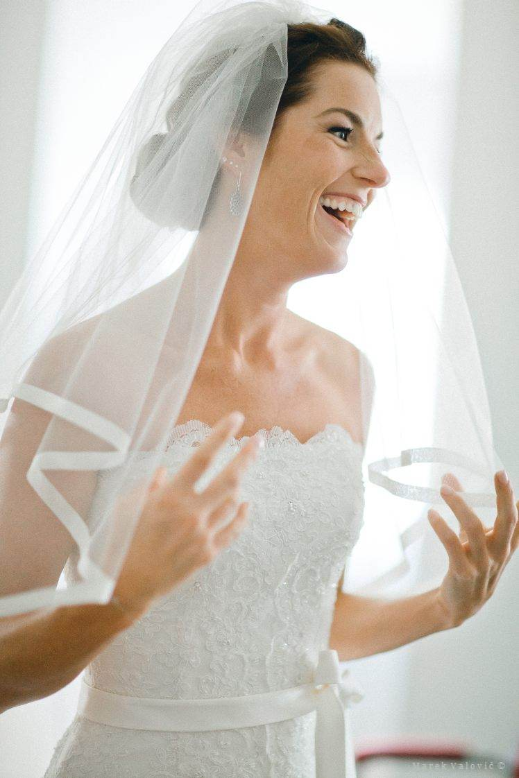 happy bride with white vail
