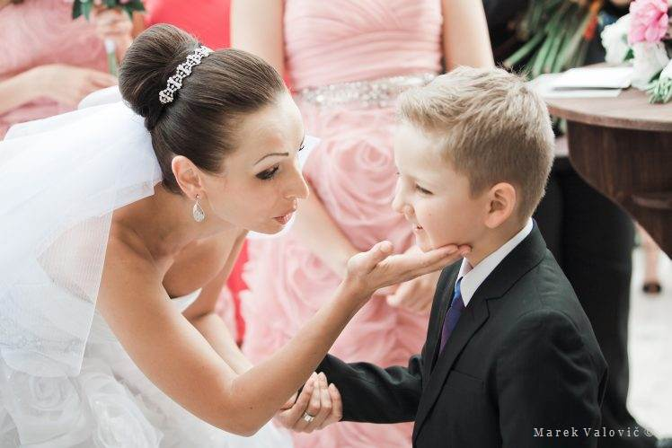 little boy congratulate to bride