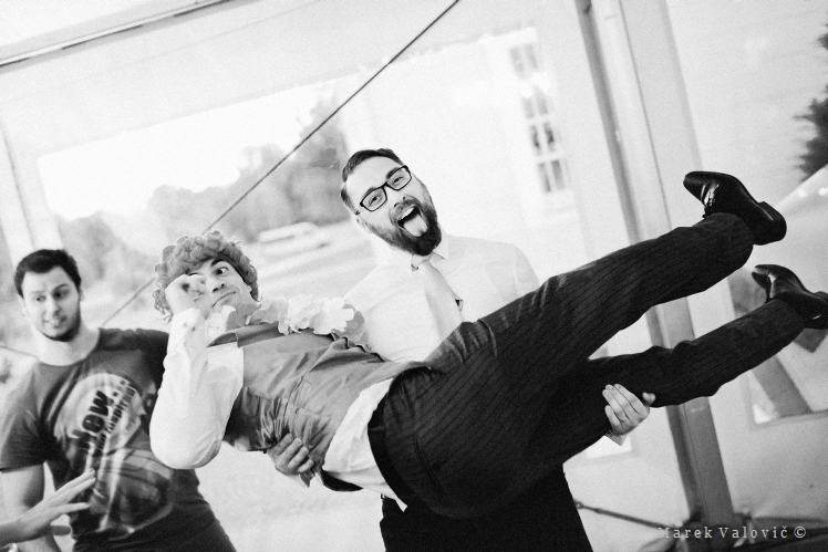wedding fun - groom lifted up