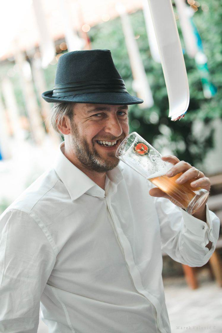 happy groom drinking beer